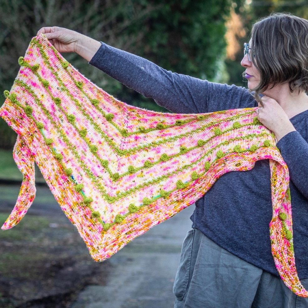 Bits & Baubs shawl, held out to show off shape and patterning