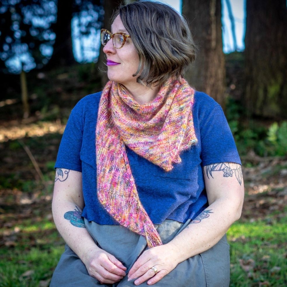 Corduroy shawl worn kerchief-like around neck