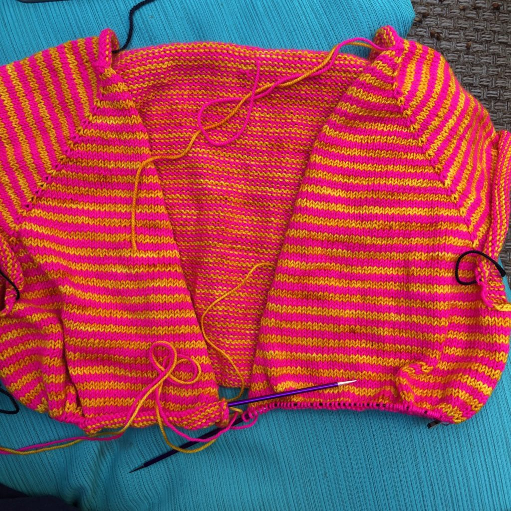 pink and yellow striped knitted sweater in progress