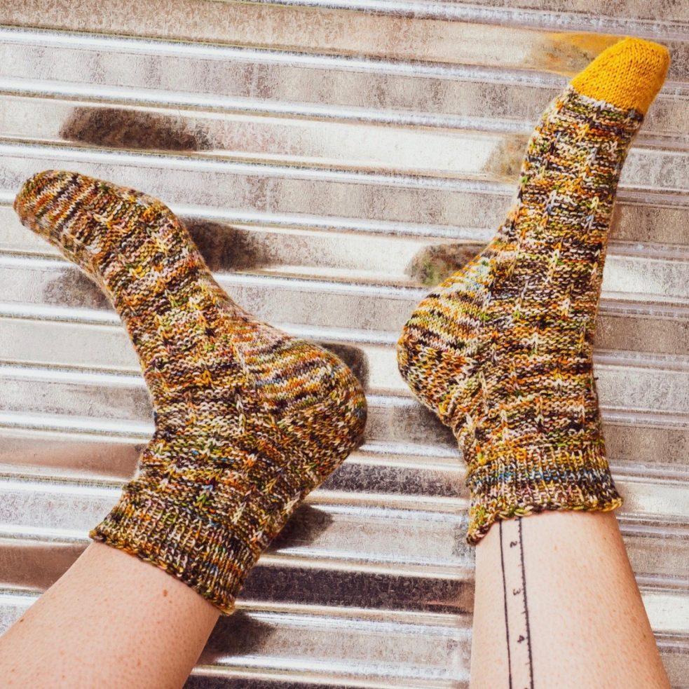 let is slip socks against tin wall