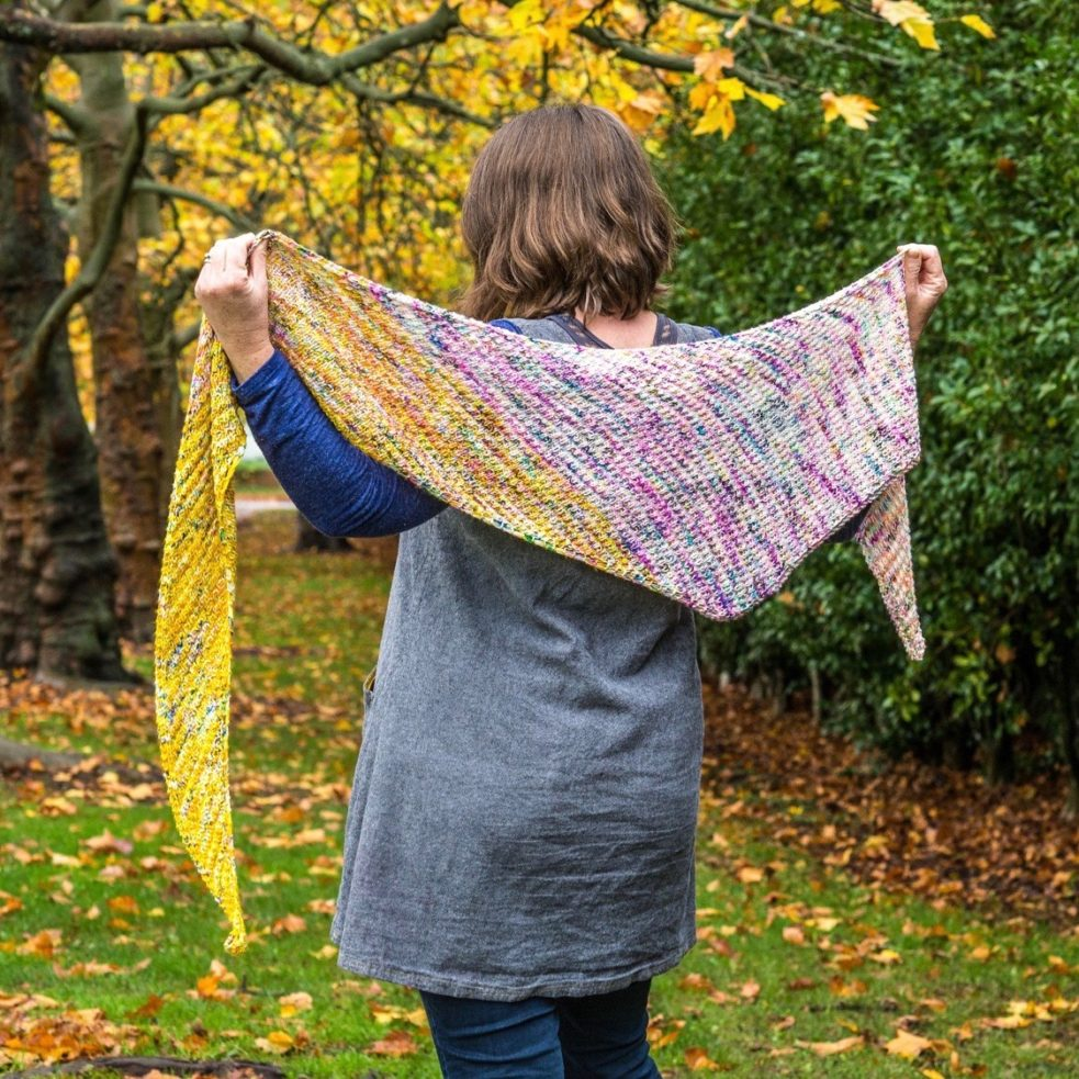 spell shawl held up across back to show size and shape